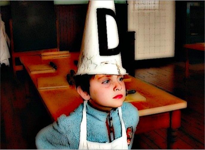 Child wearing dunce cap