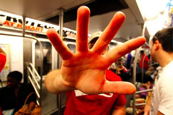 Alt Man show you his hand as in 'talk to the hand'