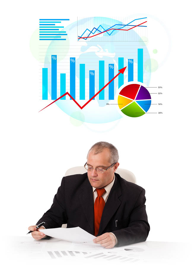 bigstock-Businessman-sitting-at-desk-wi-41438542
