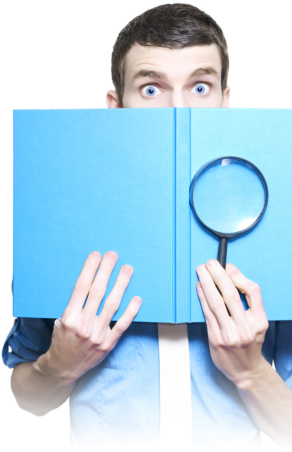 Businessman Holding Magnifying Glass And Book